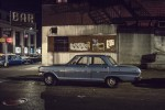 Parked Cars Under Streetlamps in 1970s New York City[4]